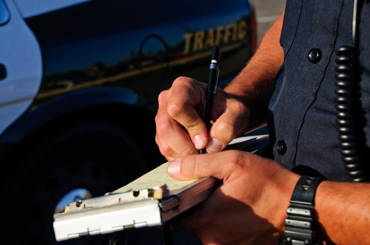 cop writing ticket